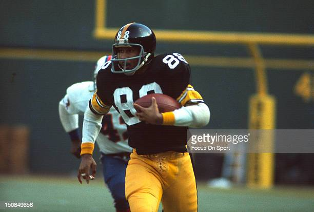Wide Receiver Lynn Swann of the Pittsburgh Steelers runs away from a Buffalo Bills defender during an the AFC/NFL Conference playoff game December 22...