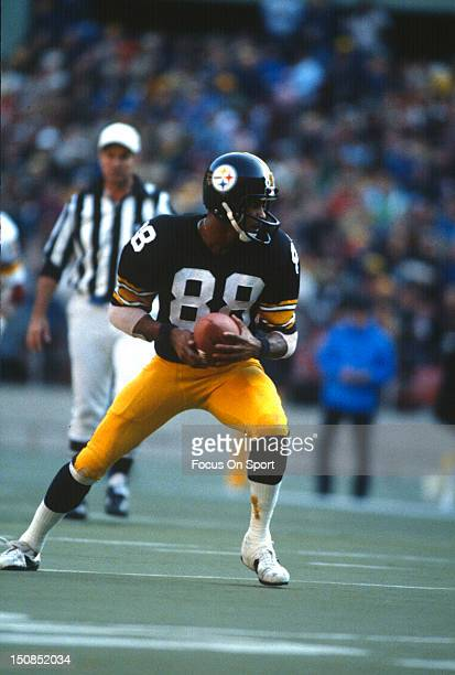 Wide Receiver Lynn Swann of the Pittsburgh Steelers runs with the ball after a catch during an NFL football game circa 1979 at Three Rivers Stadium...