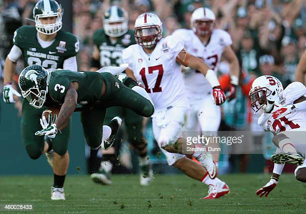 Wide receiver Macgarrett Kings Jr #3 of the Michigan State Spartans makes a catch against the Stanford Cardinal during the 100th Rose Bowl Game...