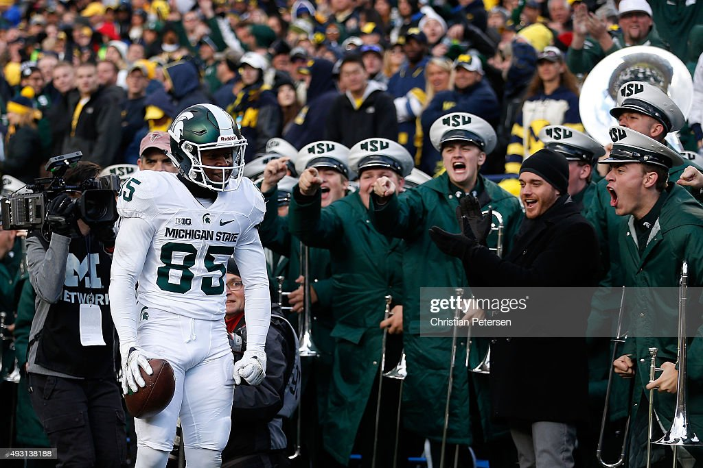 Wide receiver Macgarrett Kings Jr. #85 of the Michigan State Spartans reacts after scoring a 30 yard touchdown reception against the Michigan Wolverines during the third quarter of the college football game at Michigan Stadium on October 17, 2015 in Ann Arbor, Michigan. The Spartans defeated the Wolverines 27-23.
