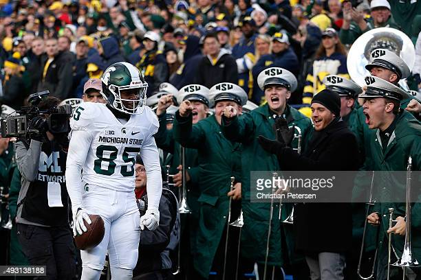 Wide receiver Macgarrett Kings Jr. #85 of the Michigan State Spartans reacts after scoring a 30 yard touchdown reception against the Michigan...