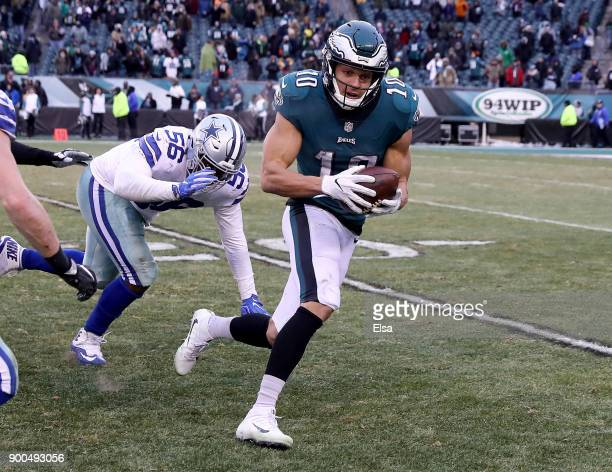 Wide receiver Mack Hollins of the Philadelphia Eagles recovers a fumble in the final second of the game as Datone Jones of the Dallas Cowboys defends...