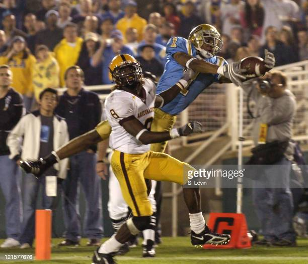 UCLA wide receiver makes a reaching endzone reception over ASU defensive back Keno WalterWhite for a touchdown during the Arizona State vs UCLA game...