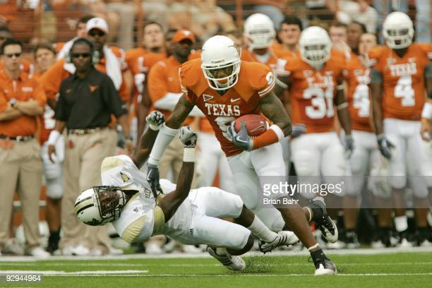 Wide receiver Malcolm Williams of the Texas Longhorns stiff arms cornerback Justin Boddie of the UCF Knights in the second quarter on November 7 2009...