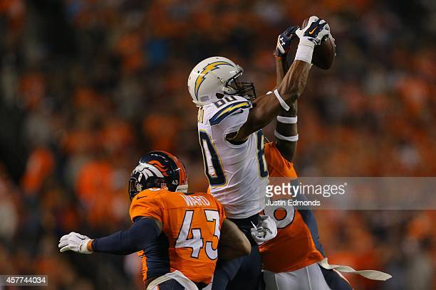 Wide receiver Malcom Floyd of the San Diego Chargers has a third quarter reception under coverage by strong safety TJ Ward of the Denver Broncos...