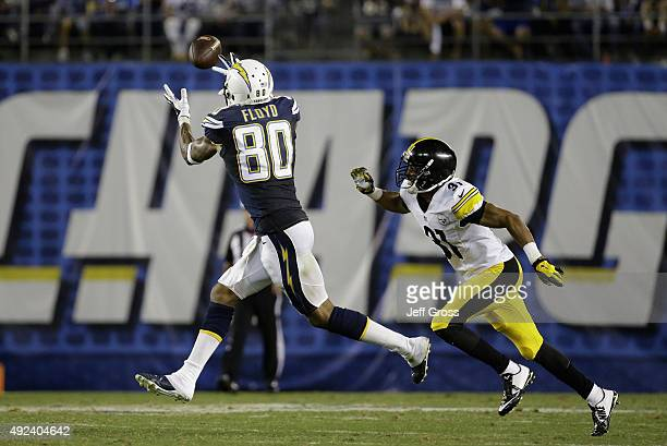 Wide receiver Malcom Floyd of the San Diego Chargers makes a reception while defended by defensive back Ross Cockrell of the Pittsburgh Steelers at...
