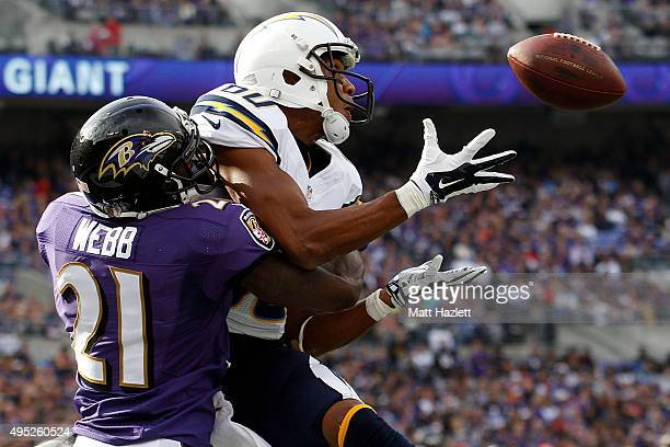 Wide receiver Malcom Floyd of the San Diego Chargers scores a second quarter touchdown past cornerback Lardarius Webb of the Baltimore Ravens during...