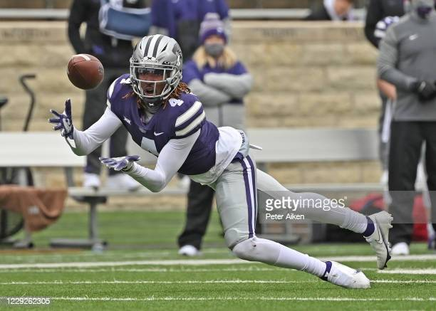 Wide receiver Malik Knowles of the Kansas State Wildcats makes a diving catch during the second half against the Kansas Jayhawks at Bill Snyder...