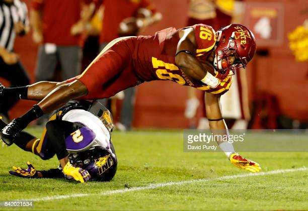 Wide receiver Marchie Murdock of the Iowa State Cyclones falls into the end zone for a touchdown as defensive back Malcolm Washington of the Northern...