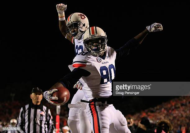 Wide receiver Marcus Davis of the Auburn Tigers celebrates his 17 yard touchdown reception with Melvin Ray of the Auburn Tigers to take a 2824 lead...