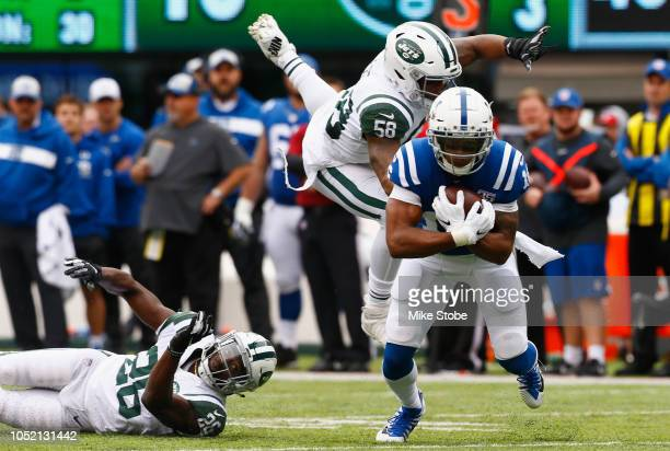 Wide receiver Marcus Johnson of the Indianapolis Colts runs the ball against inside linebacker Darron Lee and free safety Marcus Maye of the New York...
