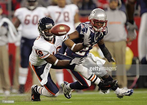 Wide receiver Mark Bradley of the Chicago Bears grabs a pass in front of cornerback Ellis Hobbs of the New England Patriots in the first half on...