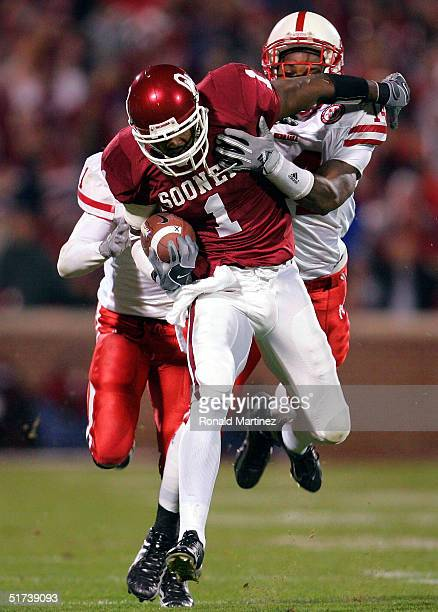 Wide receiver Mark Bradley of the Oklahoma Sooners catches a pass against safety Daniel Bullocks of the Nebraska Cornhuskers on November 13 2004 at...
