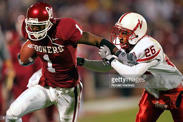 Wide receiver Mark Bradley of the Oklahoma Sooners rushes for a touchdown against cornerback Cortney Grixby of the Nebraska Cornhuskers on November...