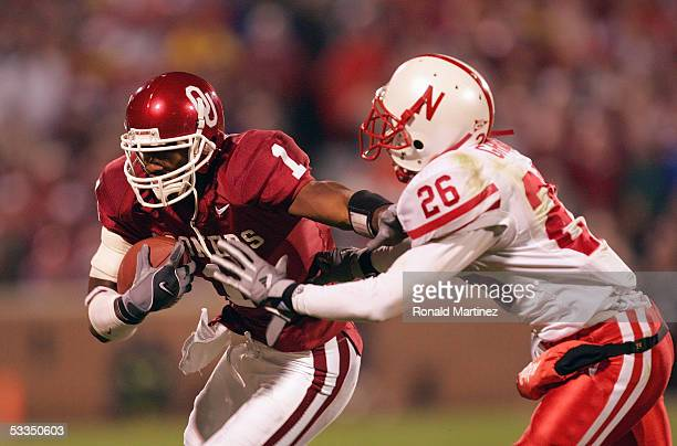 Wide receiver Mark Bradley of the University of Oklahoma Sooners runs upfield against defensive back Cortney Grixby the University of Nebraska...