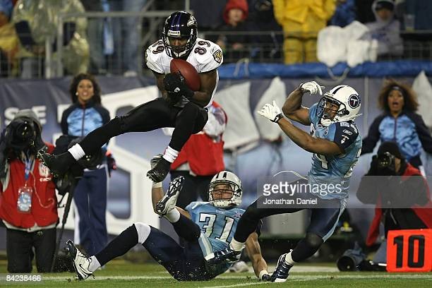 Wide receiver Mark Clayton of the Baltimore Ravens catches a 37yard pass between Cortland Finnegan and Chris Hope of the Tennessee Titans in the...