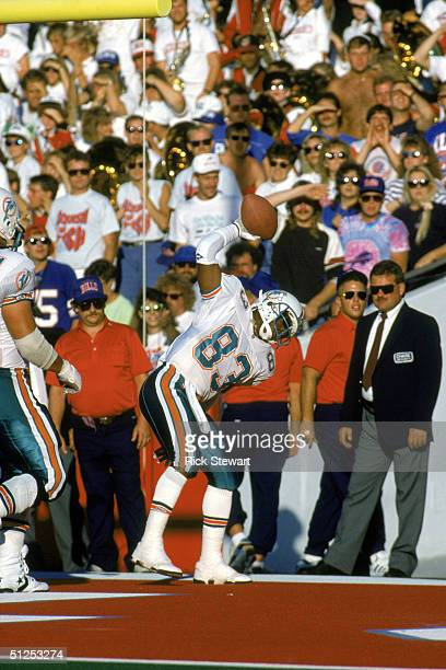 Wide receiver Mark Clayton of the Miami Dolphins celebrates after scoring a touchdown during a game against the Buffalo Bills at Ralph Wilson Stadium...