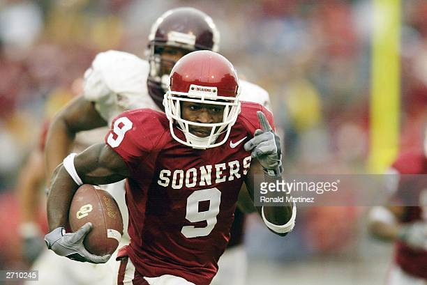Wide receiver Mark Clayton of the Oklahoma Sooners runs the ball against the Texas AM Aggies at Oklahoma Memorial Stadium on November 8 2003 in...