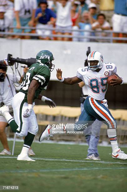 Wide receiver Mark Duper of the Miami Dolphins carries the ball against the New York Jets during the game at Dolphin Stadium in Miami Florida on...