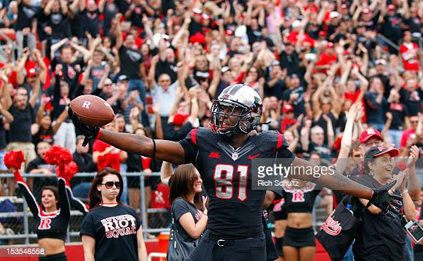 Wide receiver Mark Harrison of the Rutgers Scarlet Knights reacts after scoring a touchdown against the Connecticut Huskies in the first half as...