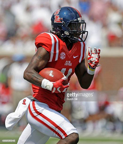 Wide receiver Markell Pack of the Mississippi Rebels catches a pass and takes it in for a touchdown during the first quarter of a NCAA college...