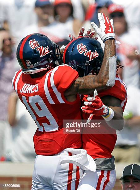 Wide receiver Markell Pack of the Mississippi Rebels celebrates with wide receiver Derrick Jones after scoring a touchdown during the first quarter...