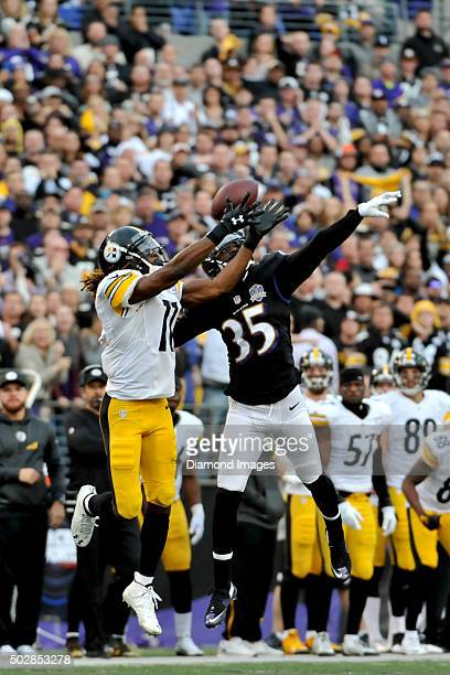 Wide receiver Markus Wheaton of the Pittsburgh Steelers fights for the ball with cornerback Sharreece Wright of the Baltimore Ravens during a game on...