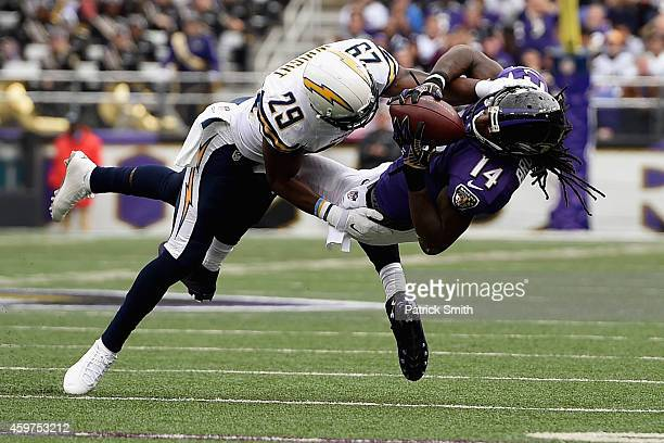 Wide receiver Marlon Brown of the Baltimore Ravens makes a second quarter catch against the defense of cornerback Shareece Wright of the San Diego...