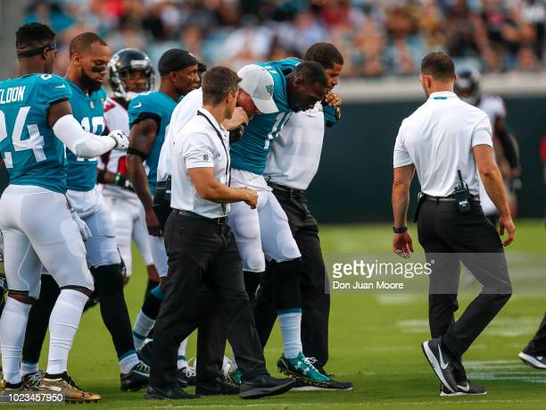 Wide Receiver Marqise Lee of the Jacksonville Jaguars is help by the medical staff of the Jaguars as he appears to have injuried his knee during a...
