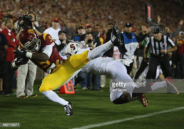 Wide receiver Marqise Lee of the USC Trojans catches a pass for a twopoint conversion while being tackled by safety Jordan Richards of the Stanford...
