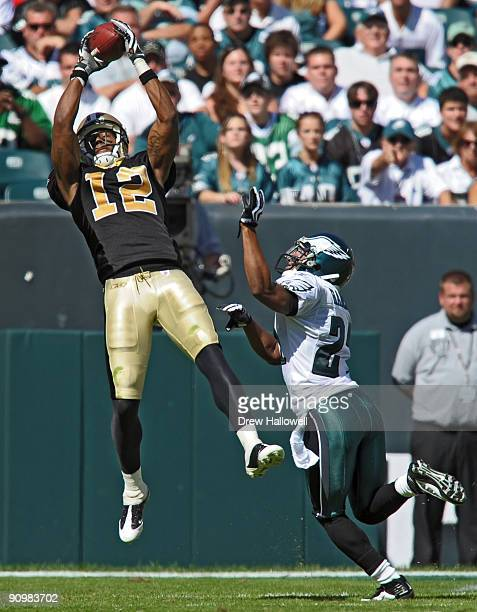 Wide receiver Marques Colston of the New Orleans Saints catches a pass for a touchdown over cornerback Joselio Hanson of the Philadelphia Eagles on...