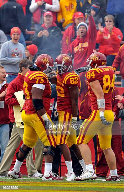 Wide receiver Marquis Hamilton of the Iowa State Cyclones celebrates with his teammates Reggie Stephens and Derrick Catlett after scoring a touchdown...