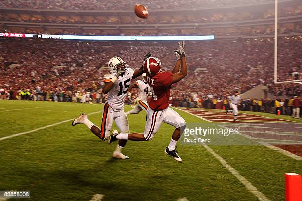Wide receiver Marquis Maze of the Alabama Crimson Tide makes a touchdown catch over defensive back Neiko Thorpe of the Auburn Tigers at BryantDenny...