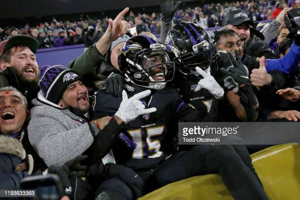 Wide receiver Marquise Brown of the Baltimore Ravens and running back Mark Ingram celebrate after a touchdown during the third quarter against the...