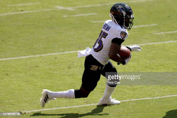 Wide receiver Marquise Brown of the Baltimore Ravens carries the ball after catching a pass against the Washington Football Team after catching a...