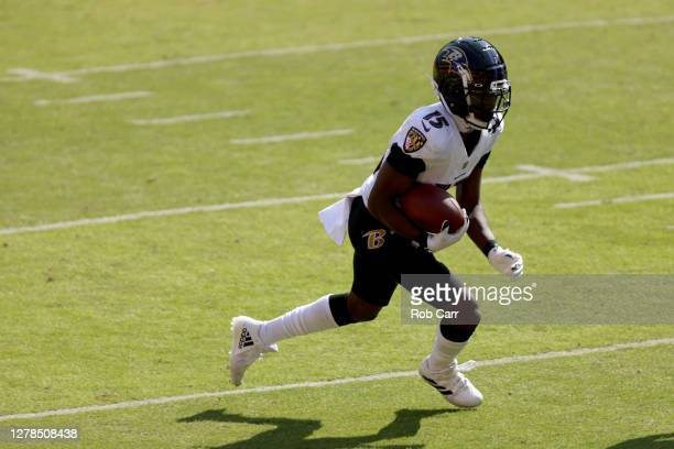 Wide receiver Marquise Brown of the Baltimore Ravens carries the ball after catching a pass against the Washington Football Team at FedExField on...