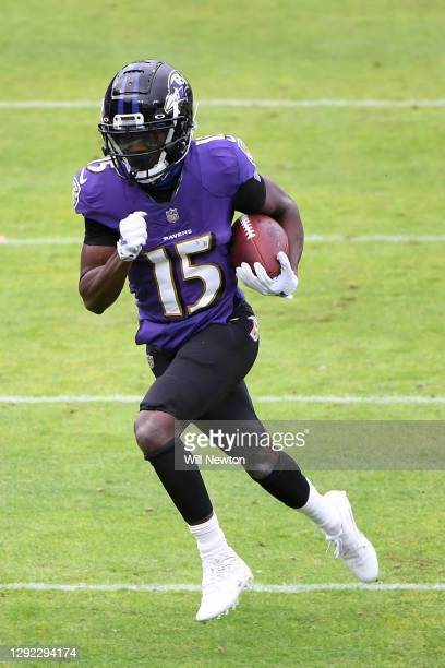 Wide receiver Marquise Brown of the Baltimore Ravens carries the ball for yardage during the first half of their game against the Jacksonville...