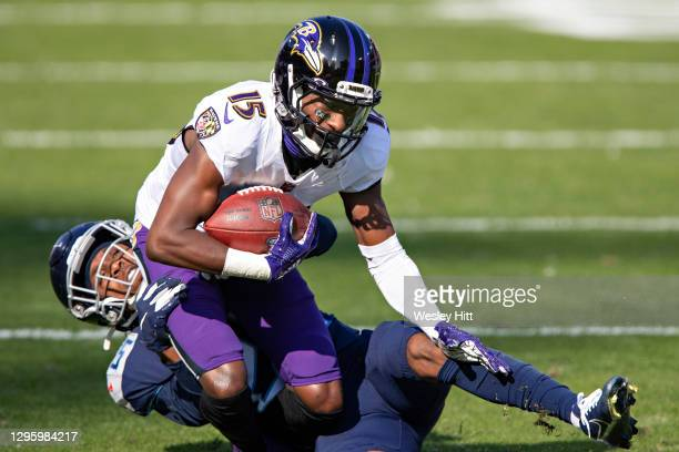 """Wide receiver Marquise Brown of the Baltimore Ravens catches a pass and is tackled during their AFC Wild Card Playoff game by Adoree""""u2019 Jackson of..."""