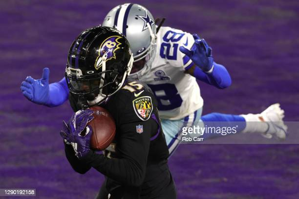 Wide receiver Marquise Brown of the Baltimore Ravens catches a touchdown against the Dallas Cowboys during the third quarter at M&T Bank Stadium on...