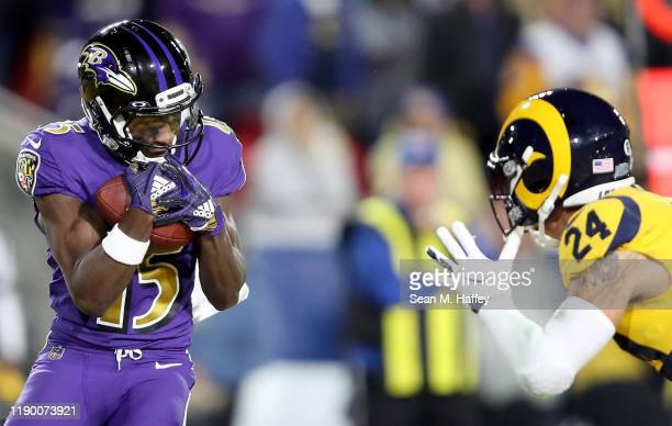 Wide receiver Marquise Brown of the Baltimore Ravens catches his second touchdown in the first quarter of the game against the Safety Taylor Rapp of...