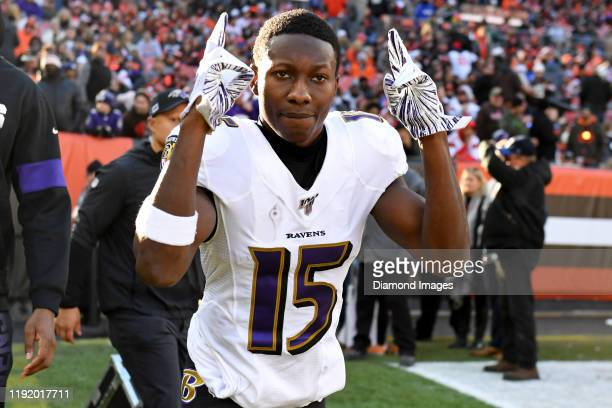 Wide receiver Marquise Brown of the Baltimore Ravens poses for a picture as he runs onto the field at halftime of a game against the Cleveland Browns...