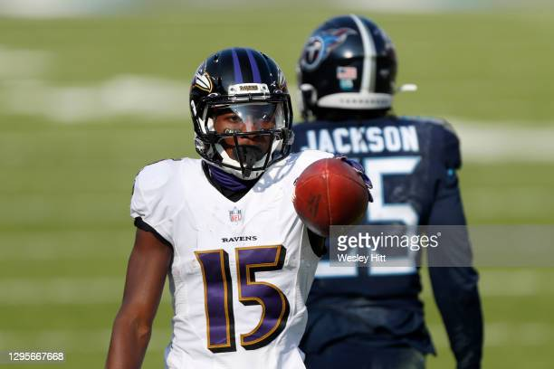 Wide receiver Marquise Brown of the Baltimore Ravens reacts following a catch against cornerback Adoree' Jackson of the Tennessee Titans during the...