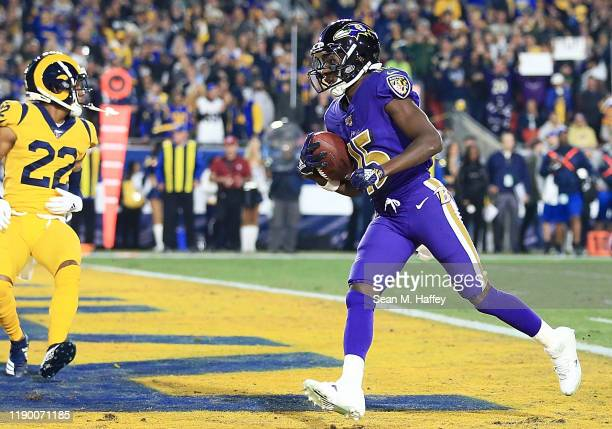 Wide receiver Marquise Brown of the Baltimore Ravens runs in his first touchdown in the first quarter of the game against the Los Angeles Rams at Los...