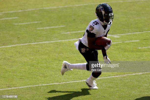 Wide receiver Marquise Brown of the Baltimore Ravens runs with the ball after catching a pass against the Washington Football Team at FedExField on...