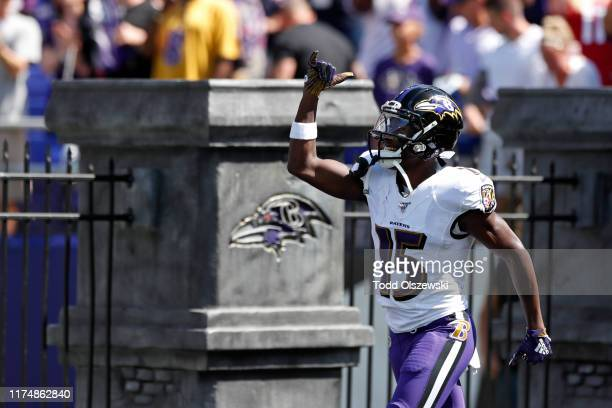 Wide Receiver Marquise Brown of the Baltimore Ravens takes the field prior to the game against the Arizona Cardinals at MT Bank Stadium on September...