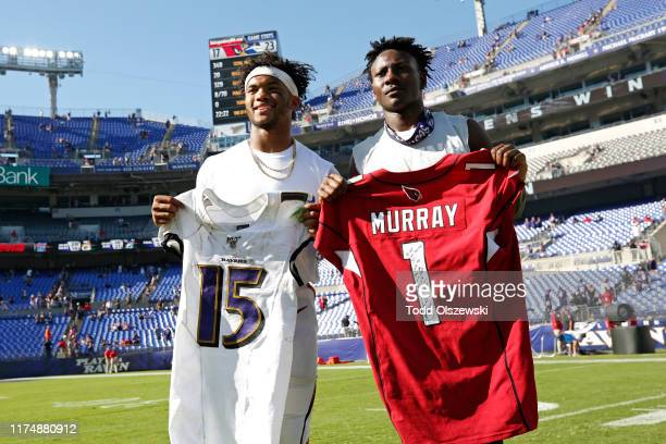 Wide Receiver Marquise Brown of the Baltimore Ravens trades jerseys with quarterback Kyler Murray of the Arizona Cardinals after the Baltimore Ravens...