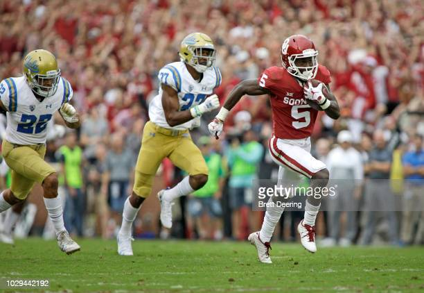 Wide receiver Marquise Brown of the Oklahoma Sooners breaks away to score against the UCLA Bruins at Gaylord Family Oklahoma Memorial Stadium on...