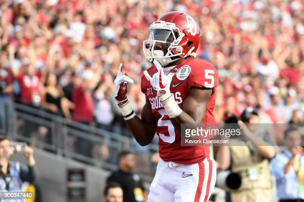 Wide receiver Marquise Brown of the Oklahoma Sooners celebrates after a 13yard touchdown catch against the Georgia Bulldogs in the first quarter in...