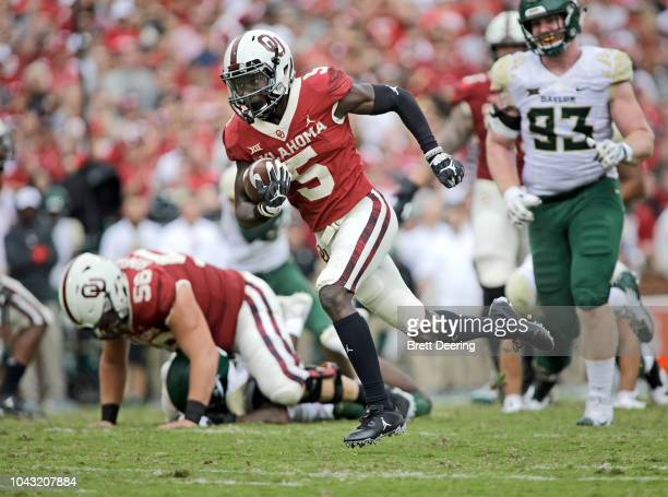 Wide receiver Marquise Brown of the Oklahoma Sooners runs down field against the Baylor Bears at Gaylord Family Oklahoma Memorial Stadium on...