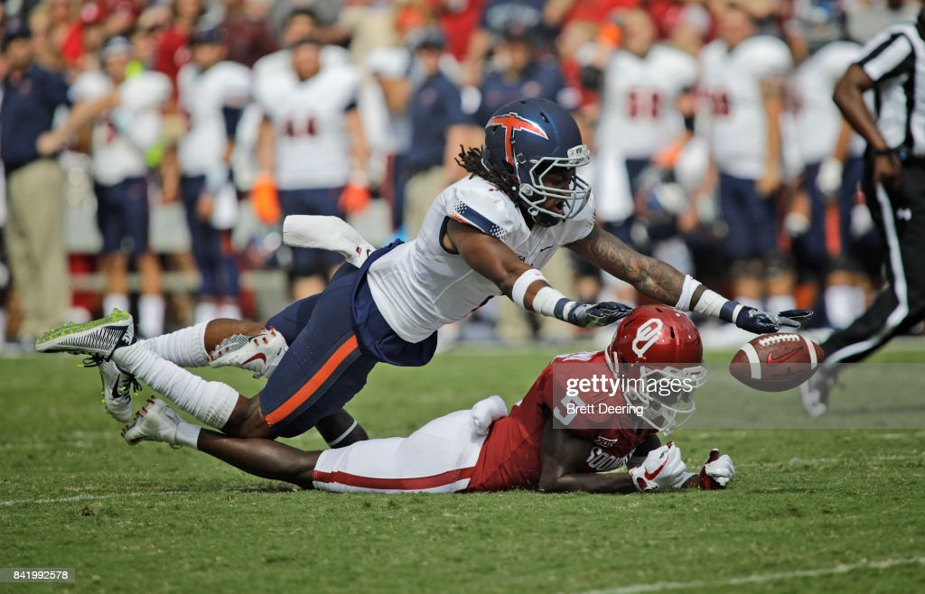 Wide receiver Marquise Brown #5 of the Oklahoma Sooners tries to catch a pass as defensive back Kalon Beverly #1 of the UTEP Miners defends at Gaylord Family Oklahoma Memorial Stadium on September 2, 2017 in Norman, Oklahoma.